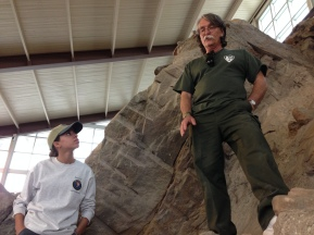 Dan Chure describes the fossils to us from precariously high up. Marie listens attentively