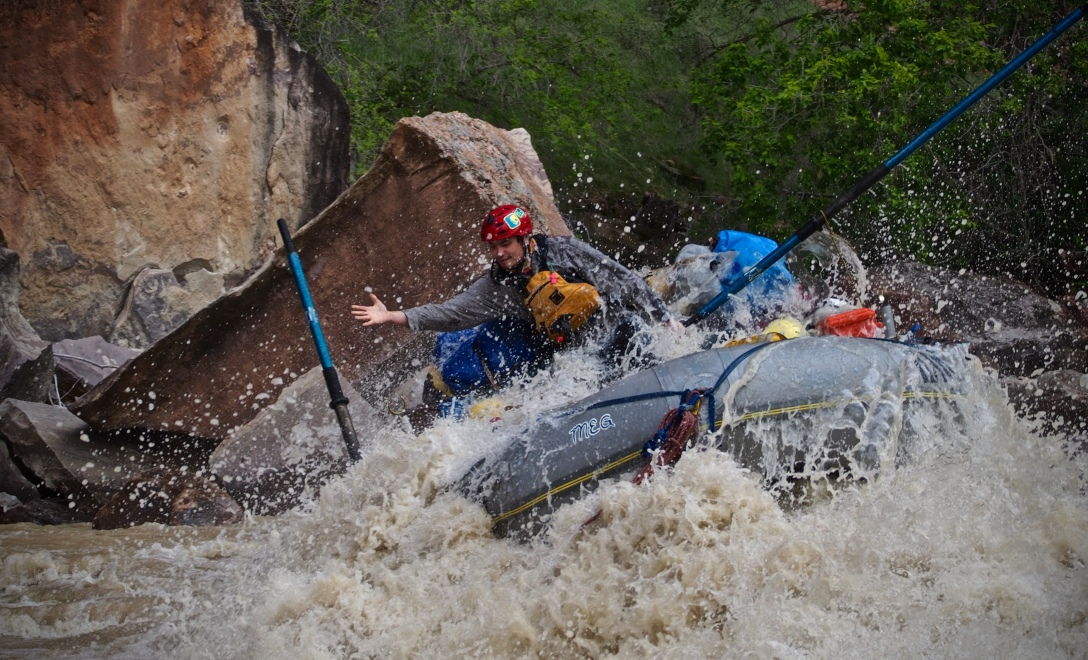 A rafter loses an oar traversing Warm Springs Rapid, on the Yampa River in the heart of Dinosaur National Monument.