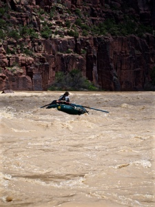 Patrick Fleming rows a Weed Warrior raft down the Yampa River