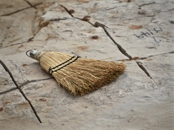 A hand broom was used to brush away dust while searching for evidence of skeletons in the rock and keeping track of the grid while sawing.